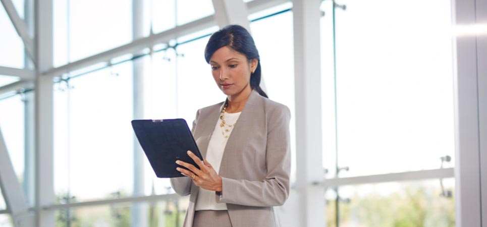 A business woman holding a tablet computer.