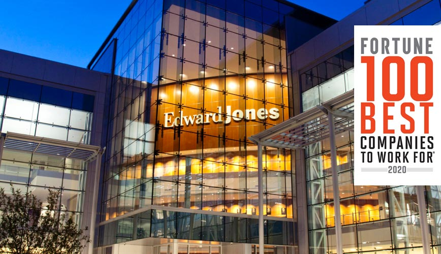 Exterior shot of an Edward Jones glass building at night.