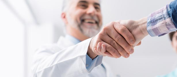 Male clinician shaking hands with patient.